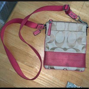 COACH pink and tan crossbody bag.